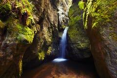 Waterfall among rock walls Royalty Free Stock Photo
