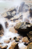 Waterfall and rocks. In mountain Stock Photo