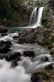 Waterfall and rocks Stock Images