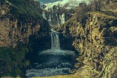 Waterfall between rocks royalty free stock photos