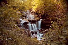 Waterfall with rocks in a autumn landscape stock photos