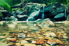 Waterfall. A waterfall through rocks and clear water royalty free stock photography