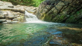 Waterfall In Rocks. Waterfall with clear water in rocks stock footage