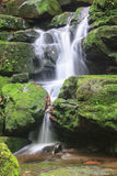 Waterfall and rocks covered with moss Royalty Free Stock Image