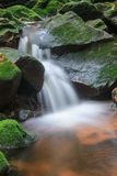 Waterfall and rocks covered with moss Royalty Free Stock Photos