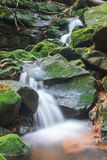 Waterfall and rocks covered with moss Stock Photo