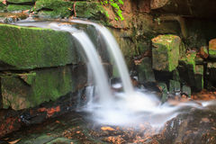 Waterfall and rocks covered with moss Stock Image