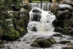 Waterfall with rocks stock images