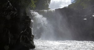 Waterfall among the rocks in Mauritius. Scenic view of waterfall with black rocks in the forest. Nature of Mauritius Island stock video