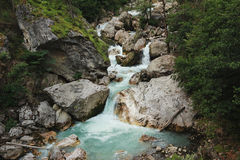 Waterfall among the rocks in mountain forest Royalty Free Stock Photography