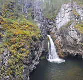 Waterfall among rocks in the Northern Urals. Royalty Free Stock Photos
