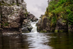 A waterfall between the rocks of Scotland. A waterfall on the island of Lewis, the Hebrides Stock Images