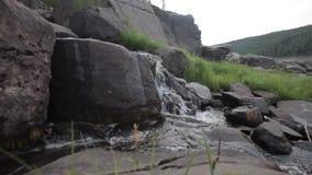 Waterfall on rocks stock video footage