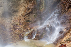 Waterfall in rocky Alps Royalty Free Stock Image