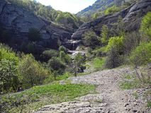 Waterfall from a rocky cleft near tourist trails. Crimean mountains.  royalty free stock images