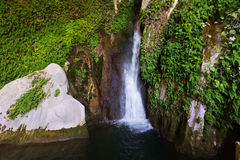 Waterfall in rocky grot. At mountains Royalty Free Stock Image
