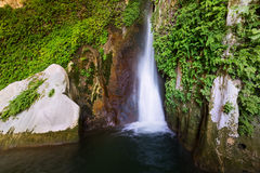 Waterfall in rocky grot. Spain Royalty Free Stock Image