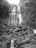 Waterfall on rocky hillside Royalty Free Stock Photo