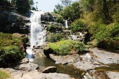 Waterfall on rocky mountain Stock Photos