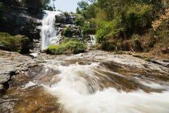 Waterfall on rocky mountain Royalty Free Stock Photos