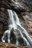 Waterfall in rocky mountains of Abkhazia stock image