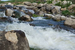 Waterfall on a rocky river. Royalty Free Stock Photography