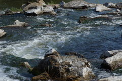 Waterfall on a rocky river. Royalty Free Stock Photos