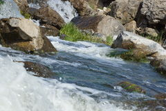 Waterfall on a rocky river. Stock Image
