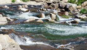 Waterfall on a rocky river. Stock Photos