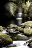 Waterfall on rocky stream Stock Photos