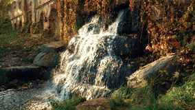 Waterfall on the Ruins in the Autumn. Evening stock video footage