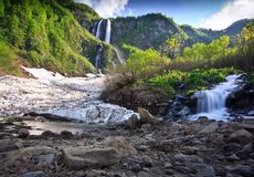 Waterfall Russia, Kavkaz. Waterfall snow mountain. Russia, Kavkaz Royalty Free Stock Photography