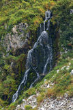 Waterfall in the Russkaya Bay at southwestern part of Avacha Gulf of Pacific ocean Royalty Free Stock Images