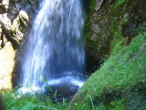 Waterfall's bottom close-up. High up to the top of the waterfall's shute, looking at the bottom pool; interior of BC., Canada Stock Photography