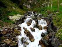 Waterfall in Samnaun. Beautiful waterfall in Europe. Its cold day, but its summer royalty free stock photo