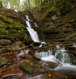 Waterfall scene. Autumn landscape with river in forest Stock Photos