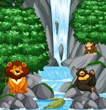 Waterfall scene with many wild animals Stock Image