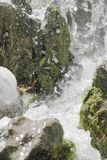 Waterfall scene in white water. Breaking on rocks Stock Images