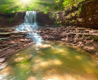 Waterfall scenery in the middle of green forest Royalty Free Stock Image