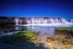 Waterfall on the sea. Waterfall at karang taraje beach Royalty Free Stock Photo