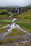 Waterfall in Sey�isfj�r�ur, an Eastern Fjord town in Iceland Royalty Free Stock Photos