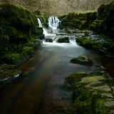 Waterfall at Sgwd Isaf Clun-Gwyn. Rocks in front of the Waterfall at Sgwd Isaf Clun-Gwyn waterfall, Brecon Beacons, Wales Stock Images
