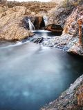Waterfall between sharp exposed rocks, the Fairy pools on the Isle of Skye Stock Photography