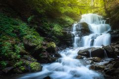 Waterfall Shypit on the Pylypets River, Ukraine. Waterfall Shypit on the Pylypets River in sun rays, Carpathian mountains, Gorgany, western Ukraine Stock Images