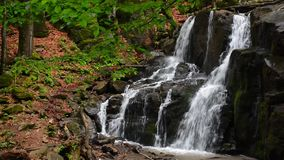 Waterfall Skakalo in deep forest stock footage