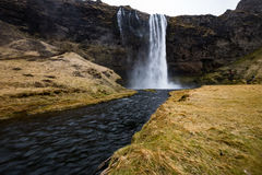 Waterfall `Skogafoss` in South Iceland. Skogafoss is a waterfall situated on the Skoga River in the south of Iceland at the cliffs of the former coastline Royalty Free Stock Images