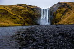 Waterfall `Skogafoss` in South Iceland. Skogafoss is a waterfall situated on the Skoga River in the south of Iceland at the cliffs of the former coastline Royalty Free Stock Photo