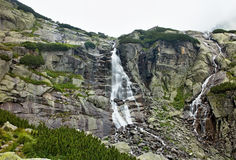 Waterfall Skok in High Tatras - Strba tarn. Stone`s in Waterfall Skok in Strbske pleso - Vysoke Tatry, Slovakia Stock Photo