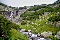 Waterfall Skok in High Tatras - Strba tarn. Stone`s in Waterfall Skok in Strbske pleso - Vysoke Tatry, Slovakia Royalty Free Stock Image