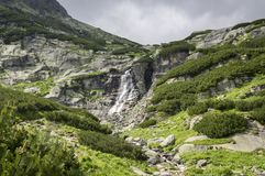 Waterfall Skok in Valley in High Tatras, Mlynska Dolina, wild slovakia mountains with touristic trail. Summer season Royalty Free Stock Photos